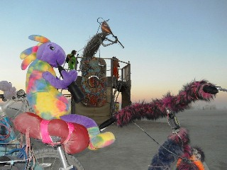 Plush Kokopelli meets Giant Wooden Kokopelli at Burning Man 2012