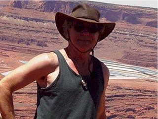 The Author, Jim McGillis, with the evaporation ponds above Potash, Utah and the Colorado River.