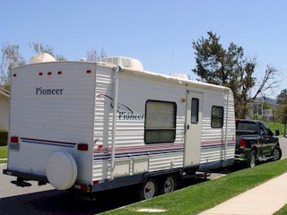 Pioneer travel trailer and Nissan Titan pickup truck
