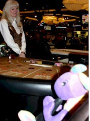 Plush Kokopelli using his silver dollar payout from Hostess Twinkies to play blackjack at the Atlantis Casino in Reno, Nevada