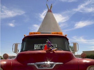 Kokopelli and Coney the Traffic Cone atop Mater the Towtruck at the Cozy Cone Motel, Holbrook, Arizona.