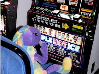 Plush Kokopelli at the dollar slots, Atlantis Casino, Reno, Nevada.