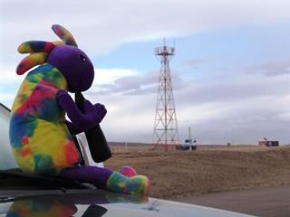 An image of Plush Kokopelli as he uses the New Energy Tower of Power to escape from the Maricopa County Jail, in Phoenix, Arizona.