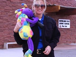 Plush Kokopelli gets a welcoming hug at Canyonlands Field, Moab, Utah