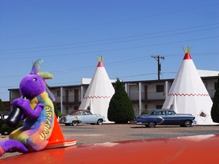 Kokopelli at rest on Coney the Traffic Cone, Wigwam Village  Motel, Holbrook, Arizona.