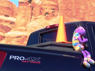 Plush Kokopelli and Coney the Traffic Cone four-wheeling in Arches National Park, Utah