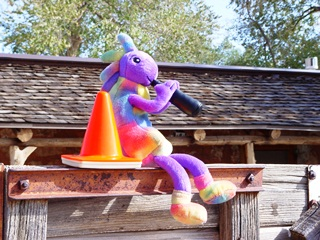 Kokopelli and Coney the Traffic Cone at Moab Ranch, prior to Kokopelli